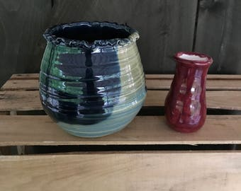 Dipped Glazed Vase done in Blues and deep greens Stands 4 and 3/4 inches high and is 5 and 3/8 inches wide