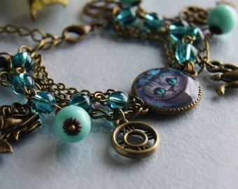 Turquoise bracelet, Cheshire Cat, Alice In Wonderland, Tim Burton, Antique bronze, Steampunk bracelet, charms bracelet, key, blue, clock