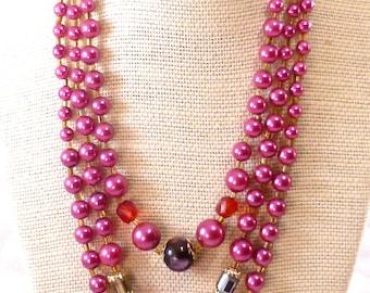 Vintage magenta triple stranded beaded necklace