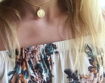 Gold strung beaded necklace with gold coin