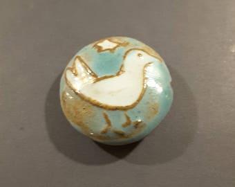 1950's glazed terra cotta hand made button.