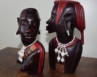 African man and woman carving.