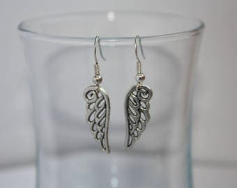 Fancy silver wing earrings