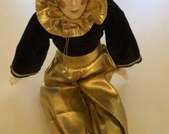 Vintage porcelain Harlequin doll from 1980's in black velvet and gold