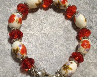 Red crystal bracelet with porcelain beads with red roses.