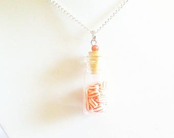 """orange milk bottle"" necklace"