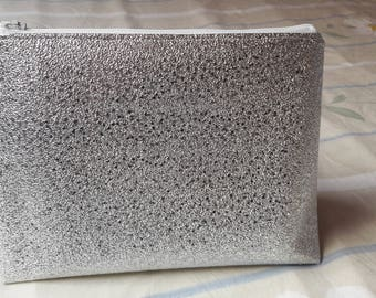 Toiletry bag in faux silver leather.