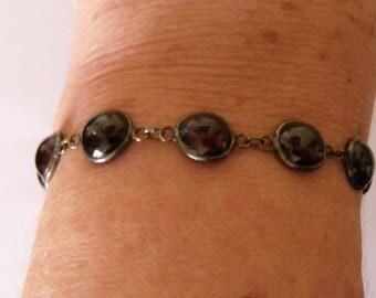 silver bracelet with garnets