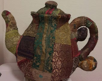 Papier teapot made with patchwork Indian fabrics on sturdy surface