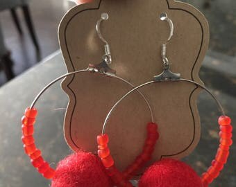 Red pom pom hoop earrings with glass beads