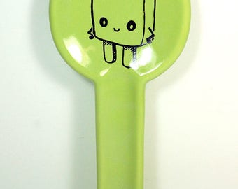 spoon rest with a Sassy Popsicle shown here on Tinda Green glaze. Made to Order / Pick Your Colour