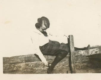 vintage photo 1919 YOung Lady Leans over Fence to Grab Heel Nice Pose