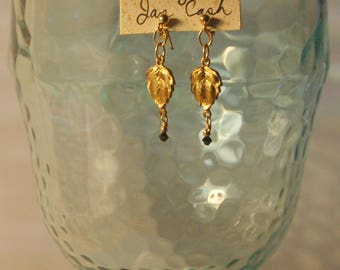 Solid leaf brass stamping and black Swarovski crystal pierced earrings with 14k gold filled posts
