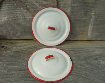 Two White with Red Trim Enamelware Lids