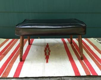 Vintage Mid Century Modern Rectangular Vinyl Foot Stool / Footrest / Ottoman - Naughahyde - Danish Modern Tapered Wood Legs - Classic Black