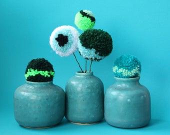 small turquoise ceramic vases