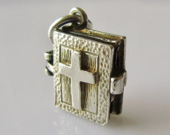 Silver Bible Charm Opens to The Lords Prayer inside.