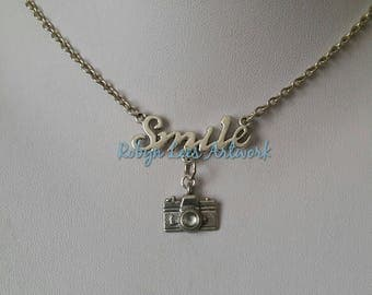 Silver Smile Word Necklace with 3D Camera Charm on Silver Crossed Chain. Photography, Photographer, Memories, Cheese