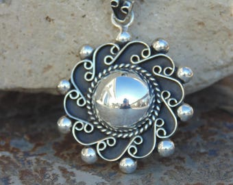 Bernice Goodspeed ~ Vintage Taxco Sterling Silver Half Globe Pendant with Ornate Swirled Design and Oxidized Background