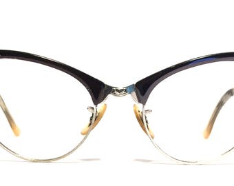 Vintage eyewear. Cat eye style. Black aluminum silver detailing. Made in USA by Art Craft. 1950's. Great Midcentury style!