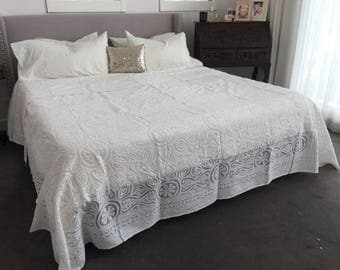Hand cut and hand sewn stunning white appliqué bedspread in organza and cotton