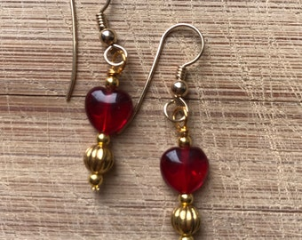 Red glass heart earrings on gold French wires
