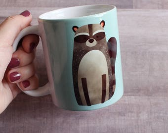 CERAMIC MUG. Tea/Coffee Raccoon White and Glossy Ceramic Mug 11 oz. Dishwasher and Microwave safe.
