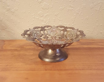 Small vintage brass round pedestal bowl.  Ornate brass pedestal bowl with cut outs.  Vintage pedestal bowl with floral motif.