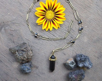 point pendant necklace with obsidian and black beads