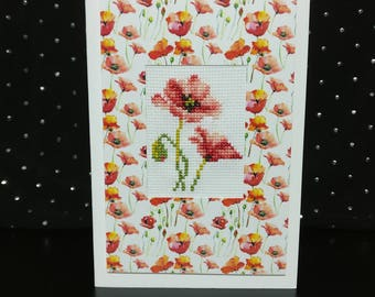 Handmade card with cross-stitched red poppies
