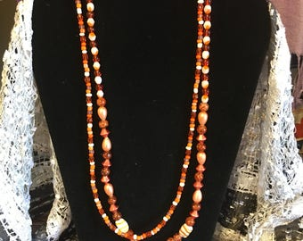 Double Stranded Orange and white beaded Necklace