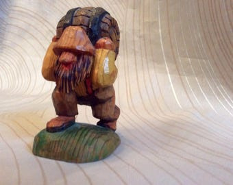 Hillbilly man, woodcarved man carrying keg, whittled man,whittling,comical whittling,comical woodcarving,comicalwhittled man,keg,beer,kegger