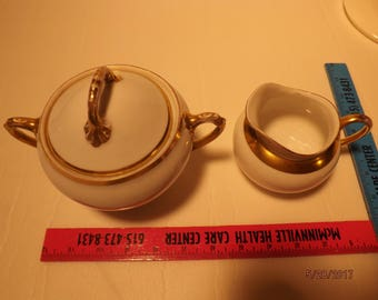 2 small bowls different makers gold trim