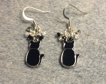 Black enamel cat silhouette charm earrings adorned with tiny dangling black and silver Chinese crystal beads.