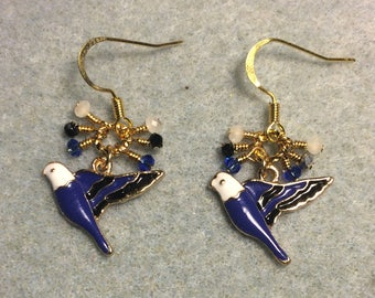 Dark blue, black, and white enamel parakeet charm earrings adorned with tiny dangling dark blue, black, and white Chinese crystal beads.