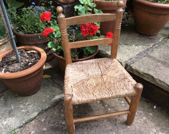 Miniature vintage pine and wicker chair.