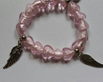 Pink hearts. Glass bracelet with wing charms.
