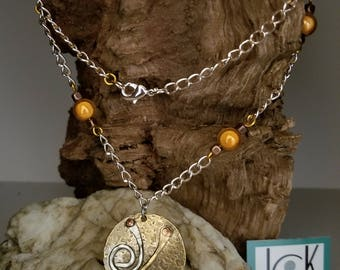 Copper and nickel medallion necklace