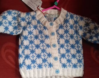 Hand knitted cardigan to fit a baby girl aged 6-9 months old