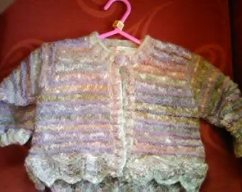 Hand knitted Cardigan, knitted in home spun wool to fit a baby girl aged 6-12 months old