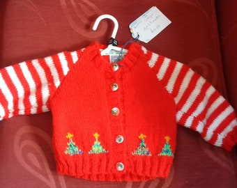 Hand knitted cardigan to fit a child aged 0-3 months old