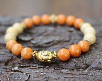 Mala bracelet with golden Buddha charm