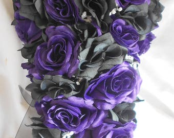 Gothic black and purple cascade wedding bouquet  made of all roses