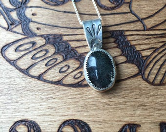 all the land glimmered - included quartz pendant with stamped detail