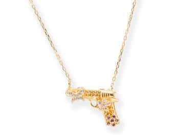 Lara Heems Gold Gun