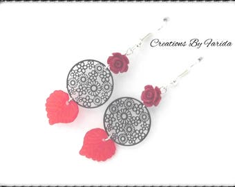 Round print floral black with a tassel and a pink and red leaf earrings