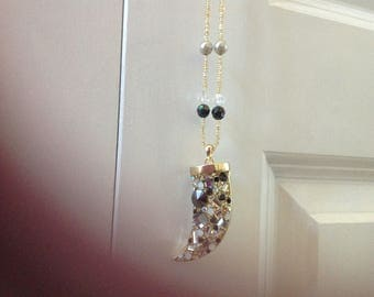 Fancy Gold And Black Rhinestone Studded Horn Pendant Necklace