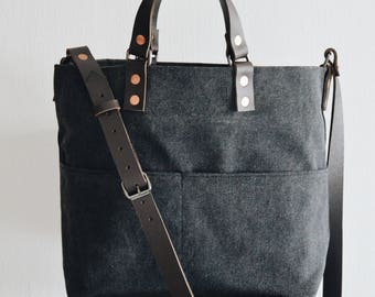 Shoulder Sling tote bag with adjustable leather strap & drop-down handles. Alaskan belt Leather Handles. Waxed Canvas .Made in Singapore