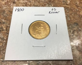 1900 Denmark 10 Kroner uncirculated      gold  .12986 agw