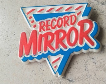 Record Mirror was a British weekly music newspaper between 1954 and 1991 for pop fans and record collectors. vintage plastic pin .